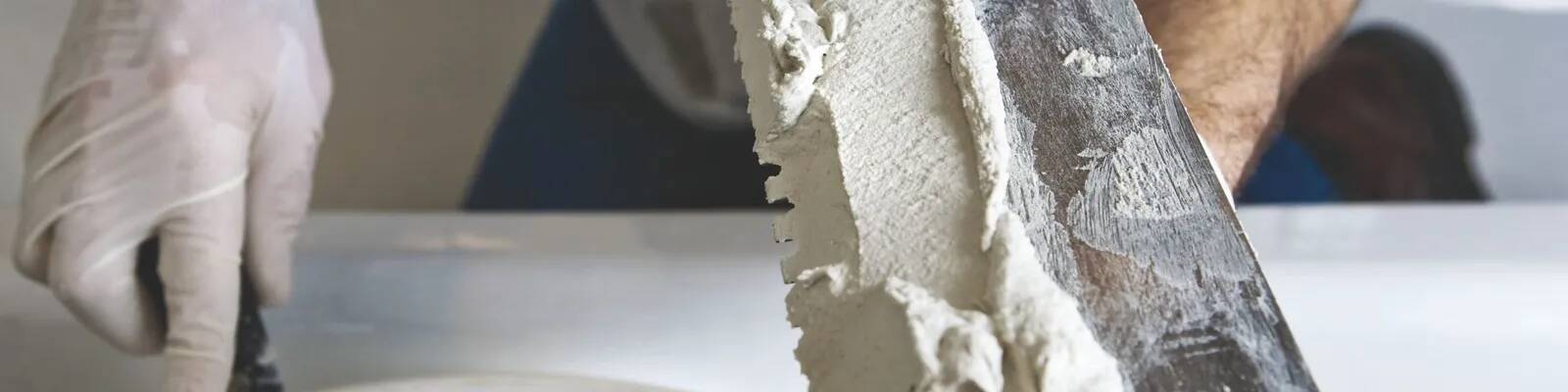 Gypsum finish and putty